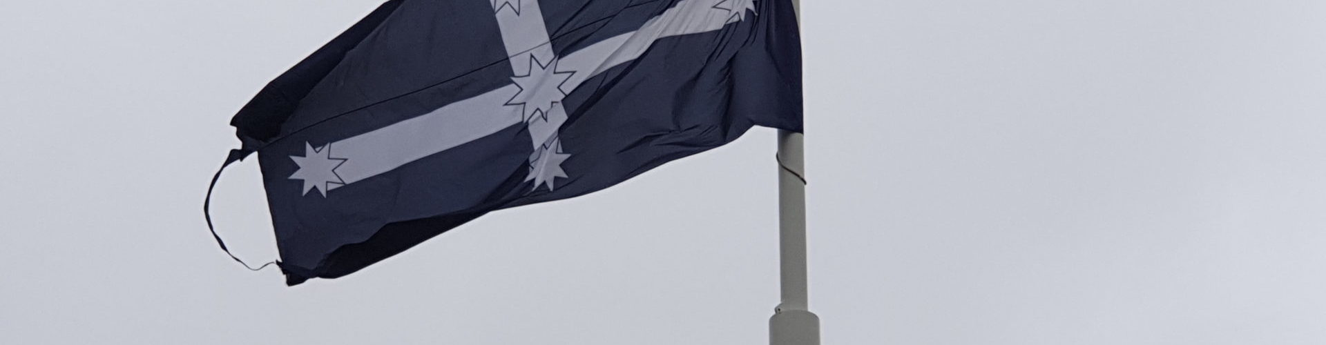 "Eureka Flag, designed by a Canadian gold miner by the name of ""Lieutenant"" Ross during the Eureka Stockade uprising in Ballarat, Victoria, in 1854. The blue background is believed to represent the blue shirts worn by many of the diggers, rather than represent the sky as is commonly thought."